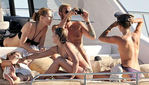rich-topless-sunbathe