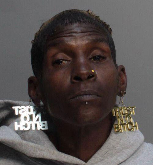 trust-no-bitch-earrings-mugshot